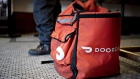 A DoorDash Inc. delivery bag sits on the floor at Chef Geoff's restaurant in Washington, D.C., U.S., on Thursday, March 26, 2020. As the wheels of government turn too slowly for small businesses desperate for a piece of the $2 trillion U.S. relief package due to the coronavirus pandemic, restaurateur Geoff Tracy is using GoFundMe to raise money for 150 hourly workers at his American comfort food standby Chef Geoff's and other restaurants. Photographer: Andrew Harrer/Bloomberg