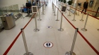 An empty security queue with social distancing markers is seen at Toronto Pearson International Airport (YYZ) in Toronto, Ontario, Canada, on Wednesday, April 8, 2020. The airport is now averaging 200 flights per day, down from 1,200 before the Covid-19 pandemic, CTV News reported.