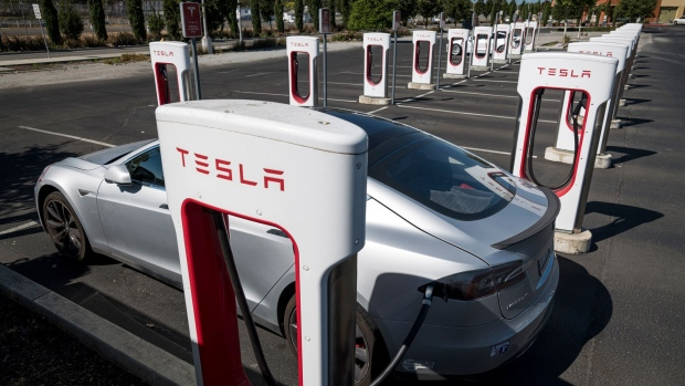 A Tesla Inc. vehicle charging at a Tesla Supercharger station in Petaluma, California, U.S., on Thursday, Sept. 24, 2020.