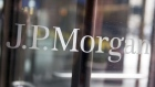 The JPMorgan Chase & Co. logo is displayed on a door at the former Bear Stearns Companies LLC. headquarters in New York, U.S., on Tuesday, April 14, 2009.