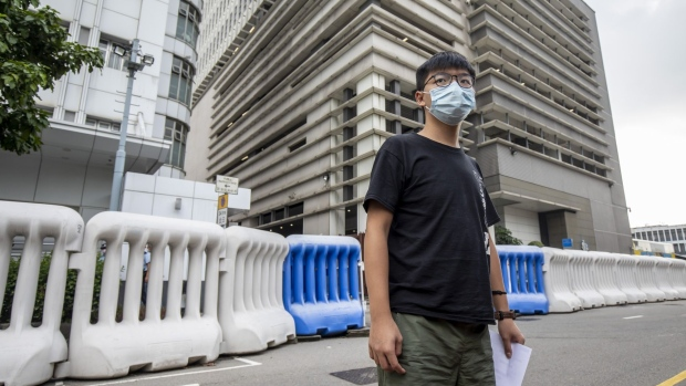 Joshua Wong, pro-democracy activist, leaves Central Police Station in Hong Kong, China, on Thursday, Sept. 24, 2020. Wong says he was arrested for allegedly participating in an unauthorized assembly on Oct. 5, 2019 and violating an anti-mask law that was introduced last year.