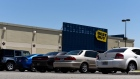 Vehicles sit parked outside a Best Buy Co. store in San Antonio, Texas.
