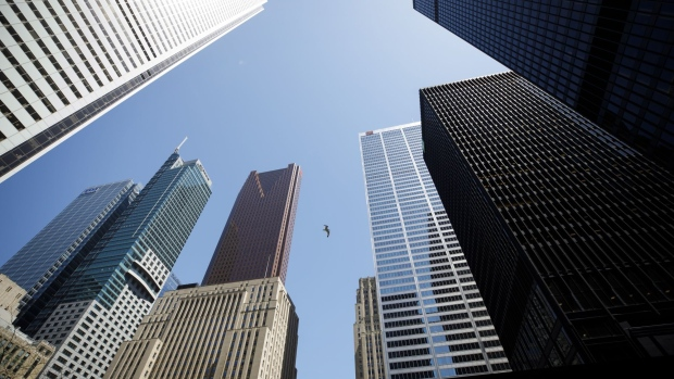 A bird flies between office towers in the financial district of Toronto, Ontario, Canada, on Friday, May 22, 2020. Whether the PATH, a subterranean network that provides connections between major commuter stations, over 80 properties, including the headquarters of Canada's five largest banks, and 1,200 retail spots, can return to its glory days will depend initially on how quickly Bay St. firms return workers to their offices. Photographer: Cole Burston/Bloomberg