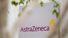 A sign featuring the AstraZeneca Plc logo stands at the company's DaVinci building at the Melbourn Science Park in Cambridge, U.K., on Monday, June 8, 2020. AstraZeneca Plc has made a preliminary approach to rival drugmaker Gilead Sciences Inc. about a potential merger, according to people familiar with the matter, in what would be the biggest health-care deal on record. Photographer: Jason Alden/Bloomberg
