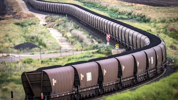 A freight train transports coal from the Gunnedah Coal Handling and Prepararation Plant, operated by Whitehaven Coal Ltd., in Gunnedah, New South Wales, Australia, on Tuesday, Oct. 13, 2020. Prime Minister Scott Morrison warned last month that if power generators don't commit to building 1,000 megawatts of gas-fired generation capacity by April to replace a coal plant set to close in 2023, the pro fossil-fuel government would do so itself. Photographer: David Gray/Bloomberg