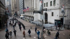 Pedestrians pass in front of the New York Stock Exchange (NYSE) in New York, U.S., on Wednesday, Feb. 26, 2020. U.S. equities swung between gains and losses as investors digested fresh evidence of the widening coronavirus outbreak. Photographer: Michael Nagle/Bloomberg