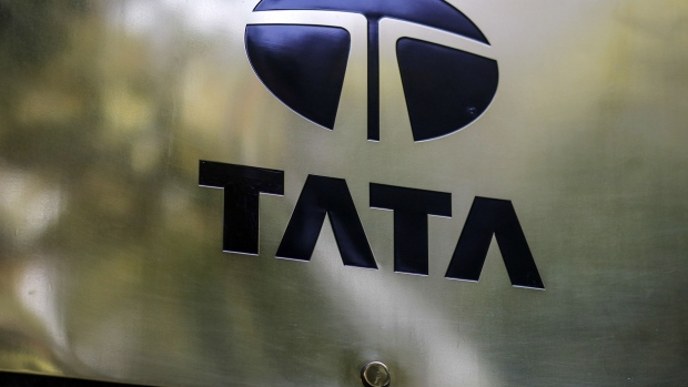 "Signage for Tata Consultancy Services Ltd. is displayed outside the company's headquarters in Mumbai, India, on Saturday, Nov. 5, 2016. Cyrus Mistry, the ousted chairman of India's biggest conglomerate, was replaced as Tata Sons chairman by his 78-year-old predecessor Ratan Tata at a board meeting on Oct. 24. Tata Sons said the conglomerate's board and Trustees of the Tata Trusts were concerned about a growing ""trust deficit"" with Mistry, which prompted the company to remove him. Photographer: Dhiraj Singh/Bloomberg"