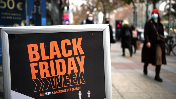 A 'Black Friday' sales sign outside a store offering discounts all week in Berlin, Germany, on Thursday, Nov. 26, 2020. With Black Friday almost underway, equity traders are bracing for a holiday season where brick-and-mortar businesses that lack strong digital platforms could suffer. Photographer: Stefanie Loos /Bloomberg