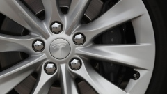 The Tesla Inc. logo sits on the wheel hub of a Tesla Model S electric automobile at the Nextmove headquarters in Leipzig, Germany, on Thursday, Aug. 15, 2019. In Europe, Tesla is racing against time as more established players wake up to the electric future. Photographer: Krisztian Bocsi/Bloomberg