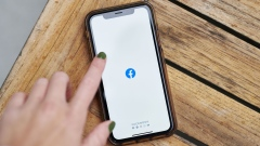 The logo for Facebook is displayed on a smartphone in an arranged photograph taken in Little Falls, New Jersey, U.S., on Wednesday, Oct. 7, 2020. Facebook Inc. is tightening its rules on content concerning the U.S. presidential election next month, including instituting a temporary ban on political ads when voting ends, as it braces for a contentious night that may not end with a definitive winner. Photographer: Gabby Jones/Bloomberg
