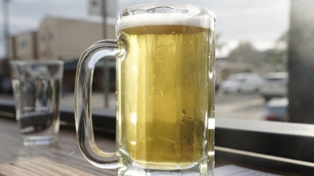 A mug of beer sits on the counter at a bar in the Ocean Beach neighborhood of San Diego, California, U.S., on Monday, June 29, 2020. Bars are required to shut in seven counties -- including Los Angeles -- and they're recommended to close in eight others, including Sacramento and Santa Barbara, following a surge in coronavirus cases, according to an order by Governor Gavin Newsom on Sunday. Photographer: Bing Guan/Bloomberg