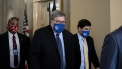 William Barr, U.S. attorney general, center, wears a protective mask while departing from the U.S. Capitol in Washington, D.C., U.S., on Monday, Nov. 9, 2020. Few Republican officeholders have been willing to publicly dispute President Donald Trump as he attacks the integrity of the election system, underscoring how he will remain a potent force in GOP politics even if he ultimately loses the White House.