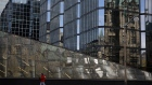 The Peace Tower on Parliament Hill is reflected in the windows of the Bank of Canada's headquarters on Oct. 28.