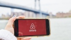 AirBnb Inc. signage is displayed on an smartphone in an arranged photograph taken in the Brooklyn borough of New York, U.S., on Friday, April 17, 2020. Home-sharing leader Airbnb Inc. lined up $1 billion in debt boosting a financial cushion it can use to grow and pay bills as the global coronavirus pandemic crushes demand for travel and diminishes the prospect of an initial public offering.