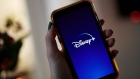 The Disney+ logo on a smartphone arranged in New York, U.S., on Wednesday, Nov. 18, 2020. Though the entertainment titan is still reeling from the pandemic, the growth of Disney+ has softened the blow. Photographer: Gabby Jones/Bloomberg