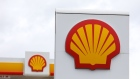 A Shell logo sits on a totem sign at a Royal Dutch Shell Plc petrol filling station in Ewell, U.K., on Wednesday, Sept. 30, 2020. Royal Dutch Shell Plc will cut as many as 9,000 jobs as Covid-19 accelerates a company-wide restructuring into low-carbon energy. Photographer: Chris Ratcliffe/Bloomberg