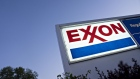 Signage is displayed at an Exxon Mobil Corp. gas station in Arlington, Virginia, U.S., on Wednesday, April 29, 2020. Exxon is scheduled to released earnings figures on May 1.