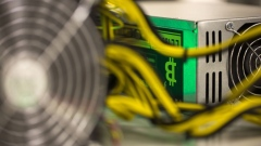 A bitcoin logo sits on a LL 1800W power unit supplying cryptocurrency mining machines at the SberBit mining 'hotel' in Moscow, Russia, on Saturday, Dec. 9, 2017. Futures on the world's most popular cryptocurrency surged as much as 26 percent in their debut session on Cboe Global Markets Inc.'s exchange, triggering two temporary trading halts designed to calm the market.