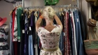 A shopper browses clothing at a second hand store in Kensington Market in Toronto, Ontario, Canada. Photographer: Brent Lewin/Bloomberg