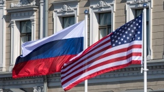 A Russian national flag, left, an American national flag, center, and a Finnish national flag fly outside the Presidential Palace in Helsinki, Finland, on Monday, July 16, 2018. U.S. President Donald Trump prepared to meet Russian President Vladimir Putin in Helsinki on Monday, under pressure to confront his Russian counterpart over Kremlin meddling in the 2016 election and with concerns rising that the U.S. is abandoning the current international order. Photographer: Chris Ratcliffe/Bloomberg Economics