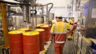 An employee watches as a machine fills barrels with lubricant oil at the Royal Dutch Shell Plc lubricants blending plant in Torzhok, Russia, on Wednesday, Feb. 7, 2018. The oil-price rally worked both ways for Royal Dutch Shell Plc as improved exploration and production lifted profit to a three-year high while refining and trading fell short of expectations as margins shrank. Photographer: Andrey Rudakov/Bloomberg
