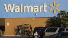 Shoppers wearing protective masks return to their vehicles outside a Walmart store in Duarte, California, U.S., on Thursday, Nov. 12, 2020. Walmart Inc. is scheduled to release earnings figures on November 17.