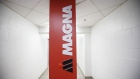 Magna International Inc. signage sits on display inside the company's Polycon Industries auto parts manufacturing facility in Guelph, Ontario, Canada, on Thursday, Aug. 30, 2018. Canadian stocks and the dollar extended gains Monday on news of a U.S.-Mexican trade agreement, shrugging off U.S. President Donald Trump's threats that Canada might be frozen out and instead face auto tariffs.