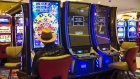 A visitor plays next to slot machines out of order to promote social distancing at the Hard Rock Hotel and Casino in Atlantic City, New Jersey, U.S., on Thursday, July 2, 2020. Atlantic City gambling, dealt a blow by newly opened betting markets in other states, was enjoying a slow comeback when Murphy ordered all nine casinos closed on March 16. Photographer: Angus Mordant/Bloomberg