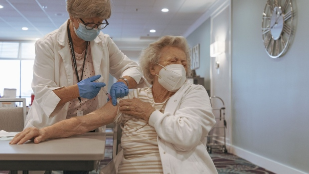 A resident receives the Moderna Covid-19 vaccine at a retirement home in Delray Beach, Florida, on Dec. 30.