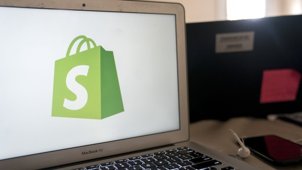 The Shopify Inc. logo is displayed on a laptop computer in an arranged photograph taken in Arlington, Virginia.