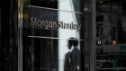 A pedestrian is reflected in the exterior of Morgan Stanley headquarters in New York. Photographer: Bess Adler/Bloomberg