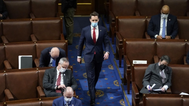 Senator Josh Hawley, a Republican from Missouri, wears a protective mask while arriving to a joint session of Congress to count the Electoral College votes of the 2020 presidential election in the House Chamber in Washington, D.C., U.S., on Wednesday, Jan. 6, 2021. The House and Senate resumed a politically charged debate over the legitimacy of the presidential election hours after a pro-Trump mob stormed the U.S. Capitol and drove lawmakers from their chambers.