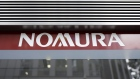 Signage for Nomura Securities Co., a unit of Nomura Holdings Inc., is displayed outside one of the company's branches in Tokyo, Japan, on Monday, July 27, 2020. Nomura Holdings is schedule to announce first-quarter earning figures on July 29. Photographer: Kiyoshi Ota/Bloomberg