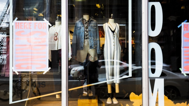 Clothing is displayed for sale in the window of an Urban Outfitters store in Boston. Photographer: Adam Glanzman/Bloomberg