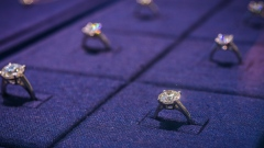 Diamond rings are displayed in a cabinet inside a De Beers SA store in Hong Kong. Photographer: Calvin Sit/Bloomberg