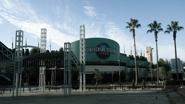 A pedestrian walks past the Universal Studios Japan theme park, in Osaka, Japan, on Monday, Nov. 30, 2020. Universal Studios Japan plans to open its $580 million Nintendo attraction on Feb. 4, finally debuting a long-delayed effort to introduce Mario and other beloved characters to real-world theme park visitors.