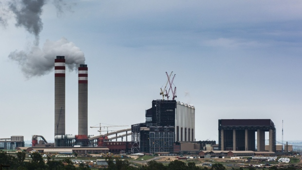 Emissions rise from towers of the Eskom Holdings SOC Ltd. Kusile coal-fired power station in Mpumalanga, South Africa, on Monday, Dec. 23, 2019. The level of sulfur dioxide emissions in the Kriel area in Mpumalanga province only lags the Norilsk Nickel metal complex in the Russian town of Norilsk, the environmental group Greenpeace said in a statement, citing 2018 data from NASA satellites.