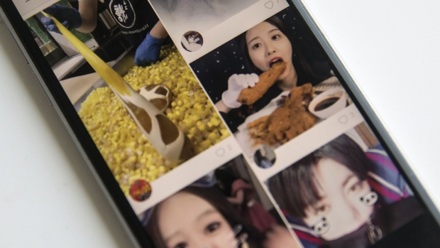 Beijing Kwai Technology Co.'s app Kuaishou, or Kwai, is arranged for a photograph on a smartphone in Hong Kong, China, on Tuesday, Jan. 16, 2018. Tencent-backed Chinese startup Kuaishou is seeking to raise funds at about a $17 billion valuation, people familiar with the matter said, as it expands its video-streaming service to Southeast Asia.