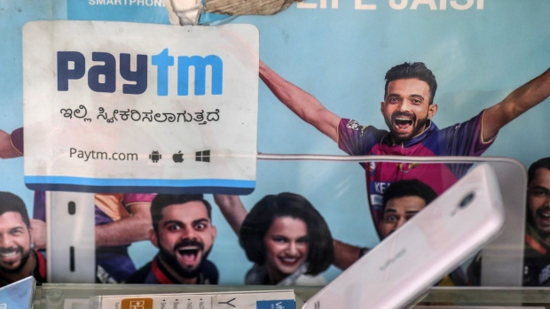 A sign for PayTM online payment method, operated by One97 Communications Ltd., is displayed at a store selling mobile phones in Bengaluru, India, on Saturday, Feb. 4, 2017. A relative laggard in digital transactions, India has more recently seen 50 percent year-on-year growth, according to a study by Google and Boston Consulting Group. The pace may accelerate with demonetization giving digital wallets like Paytm, MobiKwik and Freecharge an extra push.