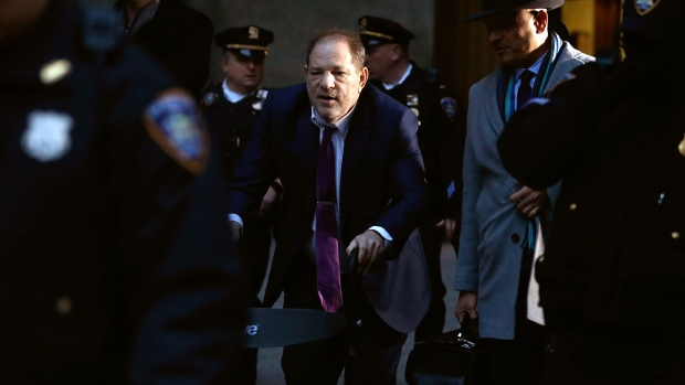 Harvey Weinstein, center, departs from state supreme court in New York on Jan. 27. Photographer: Peter Foley/Bloomberg