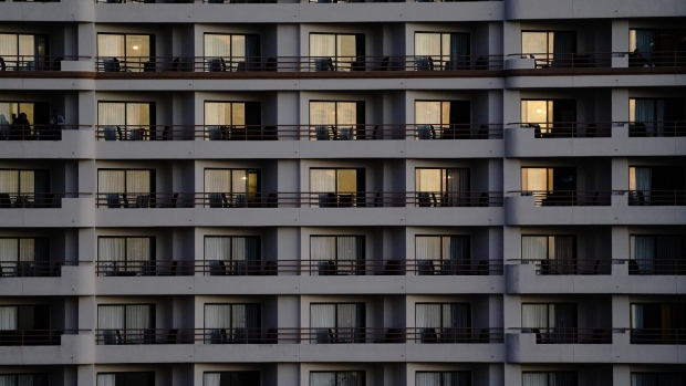 Hotel room balconies at the Waterfront Beach Resort in Huntington Beach, California, U.S., on Saturday, Dec. 12, 2020. California's average rate of positive tests over 14 days reached 8.8%, the highest since the spring as cases surged to another record. Photographer: Bing Guan/Bloomberg