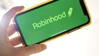 The logo for Robinhood is displayed on a smartphone in an arranged photograph taken in the Brooklyn borough of New York, on Oct. 12. Photographer: Gabby Jones/Bloomberg