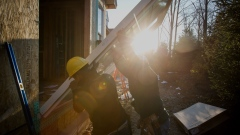 Contractors install a sliding door for a home under construction. Photographer: Michael Nagle/