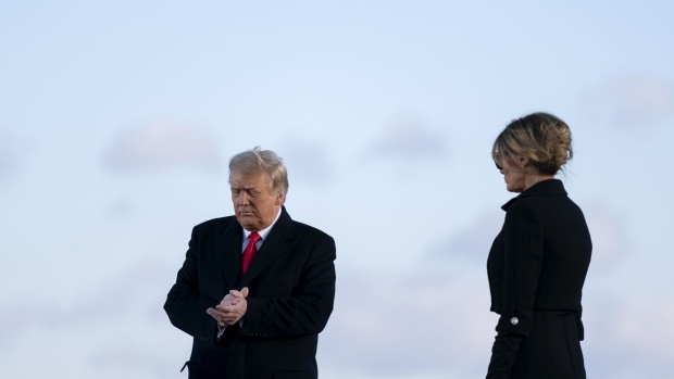 U.S. President Donald Trump, left, and U.S. First Lady Melania Trump prepare to depart a farewell ceremony at Joint Base Andrews, Maryland, U.S., on Wednesday, Jan. 20, 2021. Trump departs Washington with Americans more politically divided and more likely to be out of work than when he arrived, while awaiting trial for his second impeachment - an ignominious end to one of the most turbulent presidencies in American history.