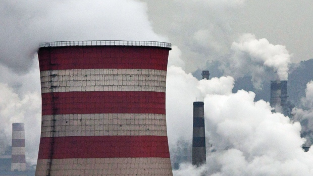 HEBEI, CHINA - NOVEMBER 19: Smoke billows from smokestacks and a coal fired generator at a steel factory on November 19, 2015 in the industrial province of Hebei, China. China's government has set 2030 as a deadline for the country to reach its peak for emissions of carbon dioxide, what scientists and environmentalists cite as the primary cause of climate change. At an upcoming conference in Paris, the governments of 196 countries will meet to set targets on reducing carbon emissions in an attempt to forge a new global agreement on climate change. (Photo by Kevin Frayer/Getty Images) Photographer: Kevin Frayer/Getty Images AsiaPac