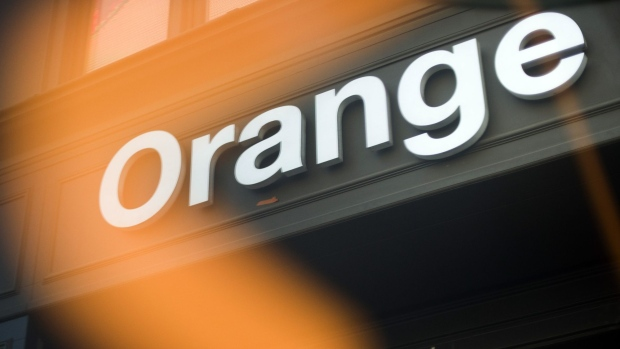 An Orange SA logo sits above the entrance to the Orange Paris Opera boutique mobile phone store in Paris, France, on Wednesday, July 29, 2020. Orange report second quarter earnings on July 30. Photographer: Nathan Laine/Bloomberg
