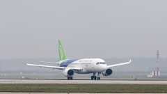 A Commercial Aircraft Corp. of China Ltd. (Comac) C919 aircraft taxis after landing at the Pudong International Airport in Shanghai, China, on Friday, May 5, 2017. China's first modern passenger jet completed its maiden test flight, giving wings to President Xi Jinping's ambition of turning China into an advanced economy.