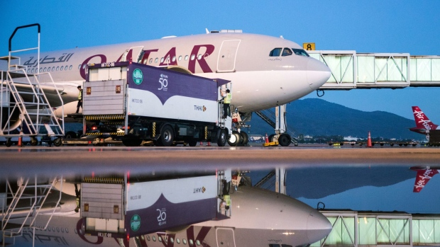 A Qatar Airways Ltd. aircraft sits connected to a passenger boarding bridge at Chiang Mai International Airport in Chiang Mai, Thailand, on Wednesday, Dec. 13, 2017. Qatar Airways launched its new direct service from Doha to Chiang Mai today. The new seasonal service will operate 4 times a week with a flight time of just over six hours. Photograph: Taylor Weidman/Bloomberg Photographer: Taylor Weidman/Bloomberg