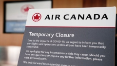 "A ""Temporary Closure"" sign is displayed on an Air Canada ticketing counter in Terminal 2 at San Diego International Airport (SAN) in San Diego, California, U.S., on Monday, April 27, 2020. U.S. airlines reached preliminary deals to access billions of dollars in federal aid, securing a temporary lifeline as the industry waits for customers to start flying again."
