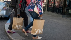 A person wearing a protective mask carries a Zara branded shopping bag in San Francisco, California, U.S., on Thursday, Aug. 6, 2020. U.S. consumer sentiment extended its slide in late July as the resurgent coronavirus led to renewed business closings and layoffs, adding to signs the economic recovery is stalling. Photographer: David Paul Morris/Bloomberg